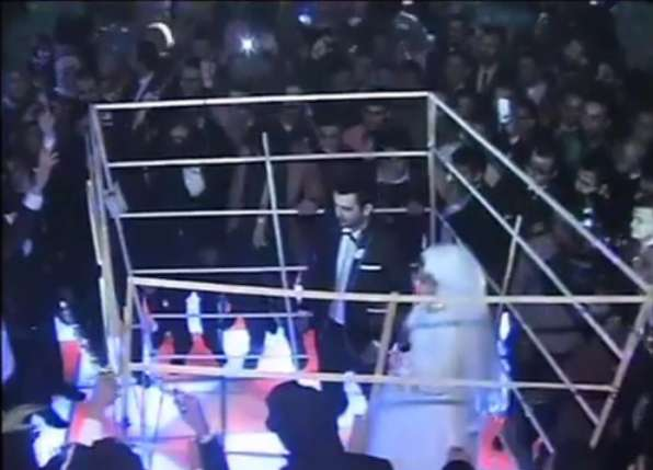 The newlyweds dancing in the cage