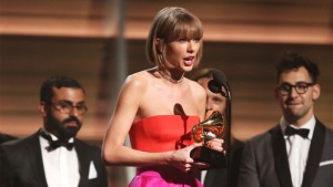 """Taylor Swift accepts the award for album of the year for """"1989"""" at the 58th annual Grammy Awards on Monday, Feb. 15, 2016, in Los Angeles. (Photo by Matt Sayles/Invision/AP)"""