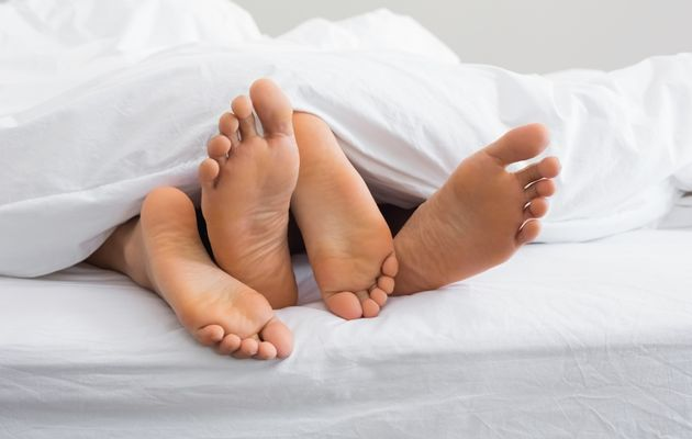 Couple+canoodling+in+bed